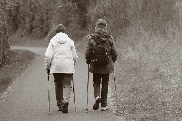 two ladies using walking poles